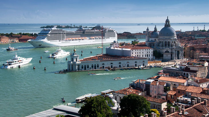 A cruise ship sailing through Venice