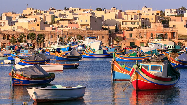 Traditional Maltese boats in a harbour