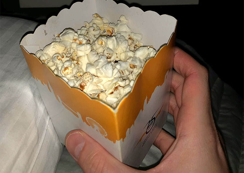 The crew even served popcorn to munch on while I watched a film