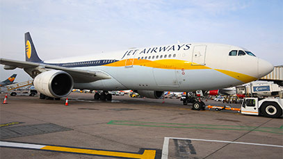 A Jet Airways plane preparing to depart from Manchester Airport