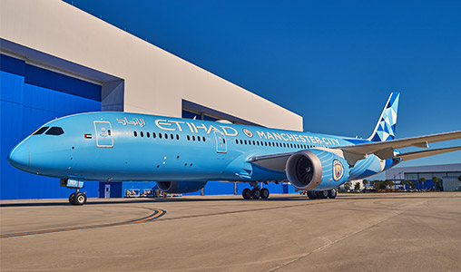 An Etihad Dreamliner plane painted in Manchester City colours.